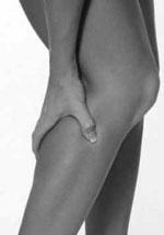 Kramper i benene hos en kvinde